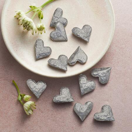 These lovely pewter heart tokens make it easy for you to share your love.
