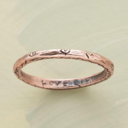 The sweet design of this rose gold vitality ring complements the message it bears.