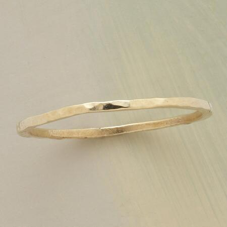 The elegance of this thin hammered 14kt gold band is worth more than its weight in gold.