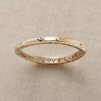 This slim yellow gold vitality ring bears a lovely design and an essential message.