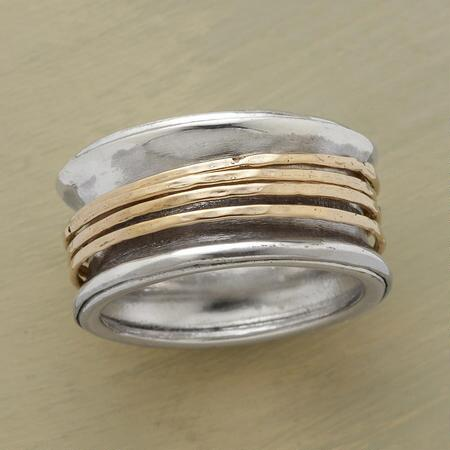 The beguiling movement of its inner bands makes this fond embrace spinner ring a stunner.
