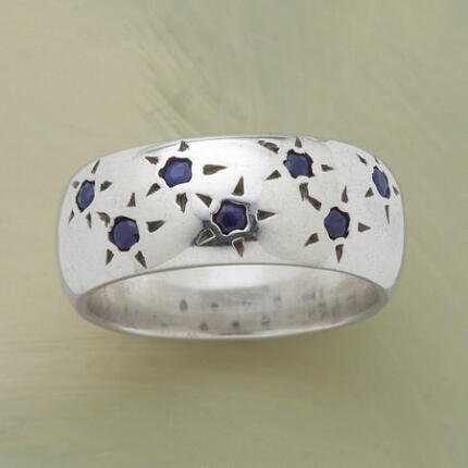 You'll always have your lucky stars with you when you wear this constellation sapphire ring.