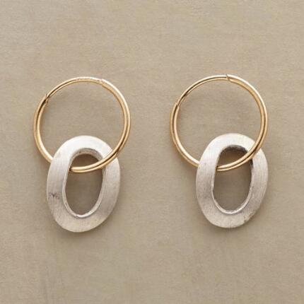 A pair of handmade hoop and loop earrings that adds a touch of playfulness to a classic look.