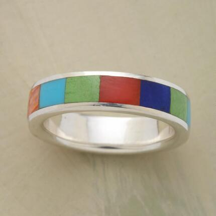 The varied colors of this global village band ring will add a lively touch to your ensemble.