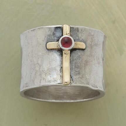 This distinctive hand-hammered cathedral gemstone ring is like nothing you've seen before.