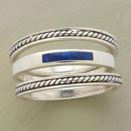 Tie your look together with this elegant lapis & silver three-ring set.