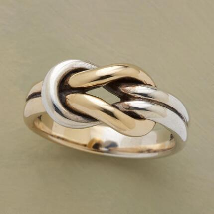 The timeless design of this tie the knot ring will wear well for a lifetime.