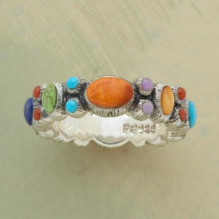 Vivid and playful, this unique cabochon multicolored ring will liven up any look.