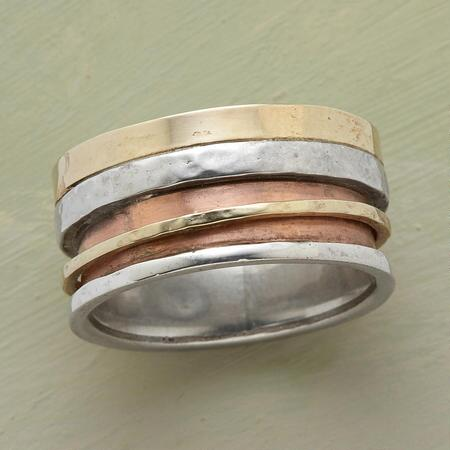 A mixed-metal duet spinner ring that surprises and delights with its varied tones and flashes of motion.