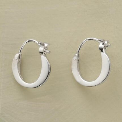 Dainty and chic, these self-locking silver hoop earrings are the perfect everyday pair.