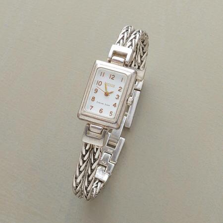 Elegant as can be, this sterling silver chain bracelet watch looks good with everything.