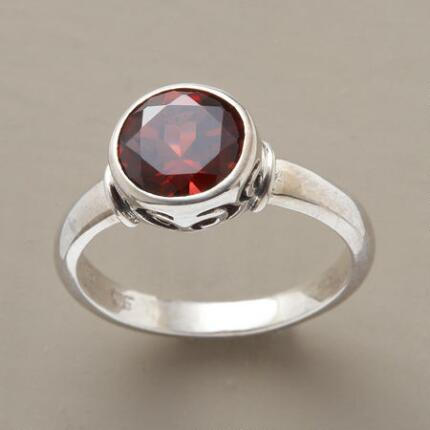 This red garnet ring has a color so rich and a setting so fine, it will make you feel like royalty.