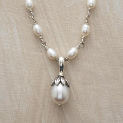 A beautiful lotus pearl necklace, blossoming with timeless luster.