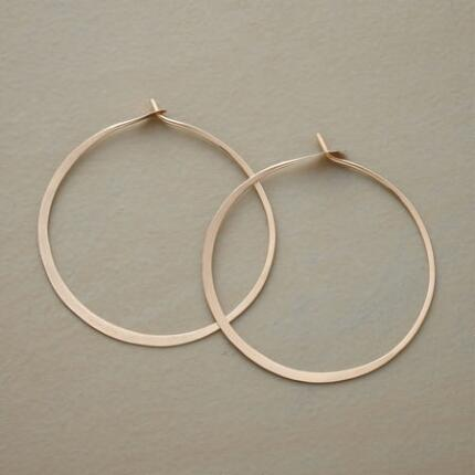 These large gold gypsy hoop earrings are a classic pair that packs oversized style.