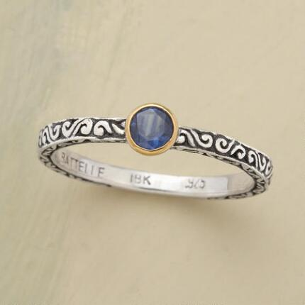 This blue sapphire scroll ring has a bantam band with outsized style.