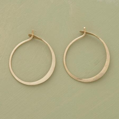 A pair of small hand-forged gold hoops so chic, you can feel free to wear them anytime, or all the time.