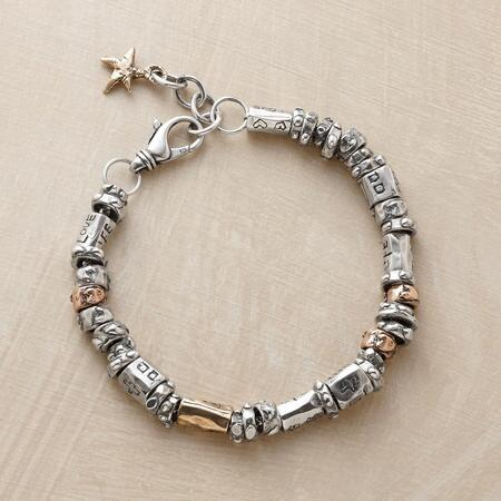 This sterling and gold charm bead bracelet speaks to life's many beauties.