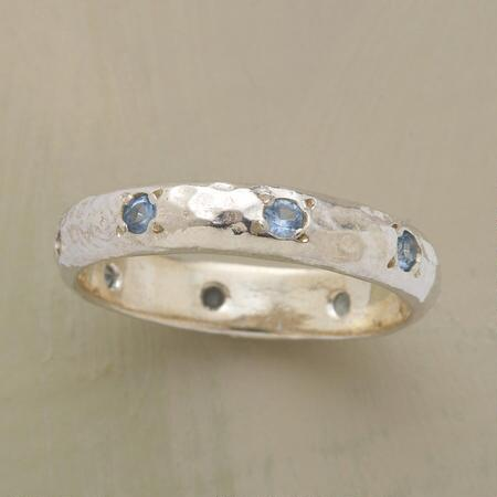 Subtle touches to the design make this blue topaz eternity band a piece you'll never stop loving.