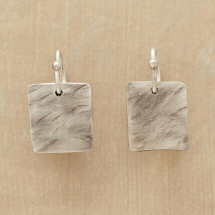Minimalist but unique, these sterling silver square earrings make a statement.