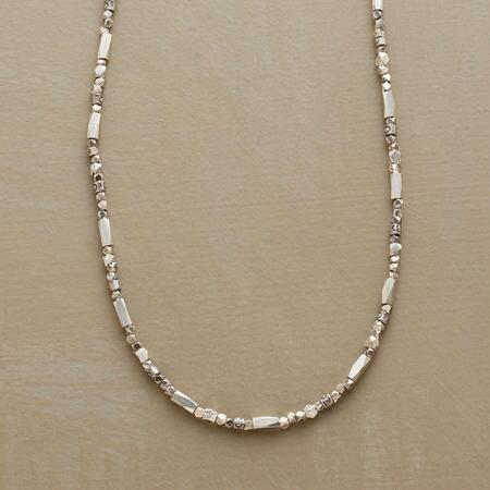 Sparklingly simple, this silver beaded necklace is the perfect everyday piece.