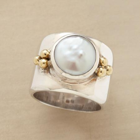 A unique coin pearl ring that makes a truly distinctive impression.
