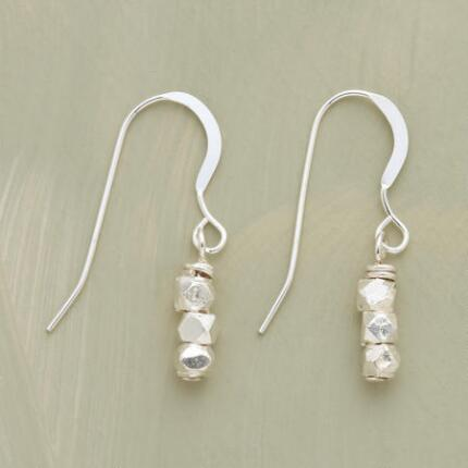 These dangling sterling silver bead earrings bring a bit of sparkle to understated refinement.