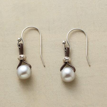 This pair of dangling button pearl earrings simply emanates subtle elegance.
