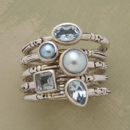 A blue gemstone ring set that brings together a collection of bands as gorgeous as it is unique.