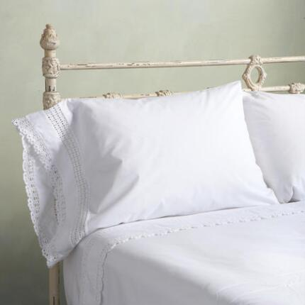 A classic cotton percale bedding set that emanates a timeless air of simple grace.