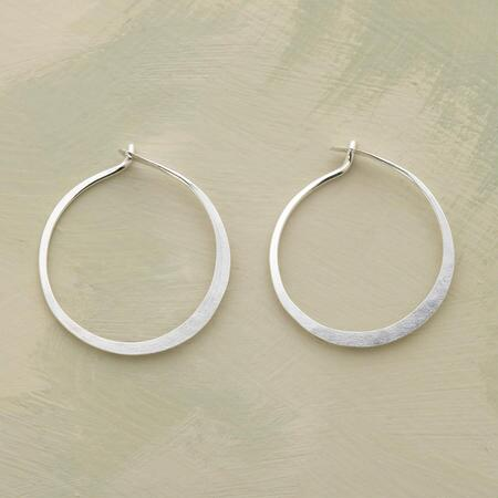 A pair of small hand-forged sterling hoop earrings that just might be your new favorite.