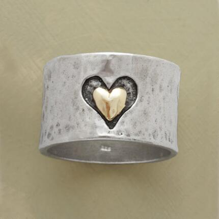Wear your heart on your finger with this heart and soul band ring.
