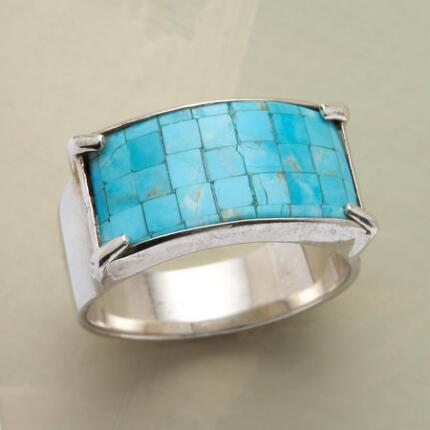 This striking turquoise mosaic ring will add a splash of color to your look.