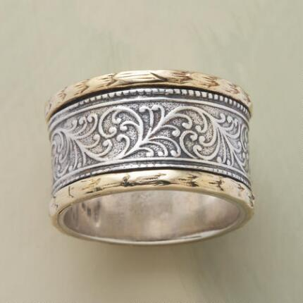 Seamlessly bring together distinct elements with this sterling and gold harmony ring.