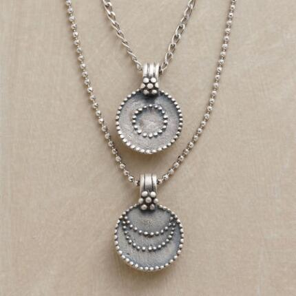 A silver sun and moon necklace that brings enchantingly cool illumination to your look.