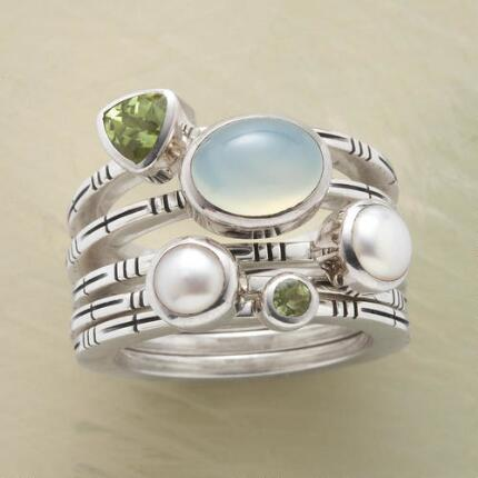 A lovely seafoam stack ring set that stuns with jewels aplenty.