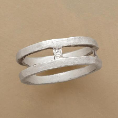 This double band connection diamond ring has a unique yet sleek design that you will love.