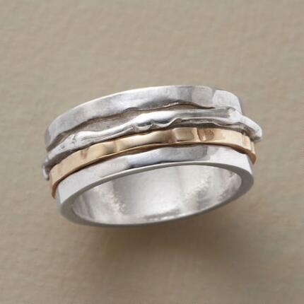 Contrasting movement lends this handmade spinner ring a flash of excitement.