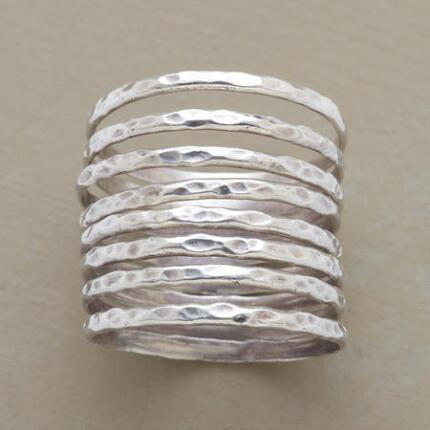 A proliferation of perfect silver bands comprise this hammered silver stack ring set.