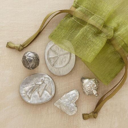 These beautiful pewter pocket charms make a meaningful memento or gift.