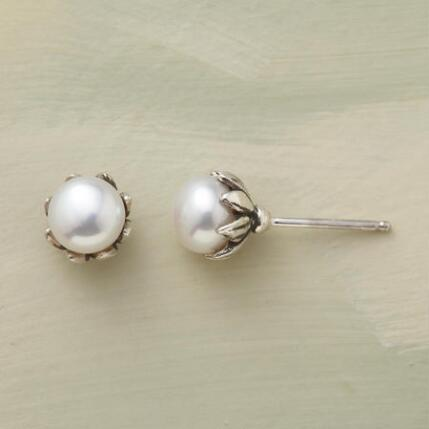 A pair of pearl and silver flower stud earrings that blossom on the ear.