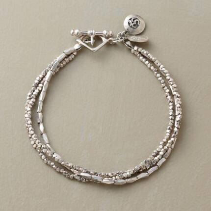 In shining harmony, this sterling silver serenity bracelet simply beams with beauty.