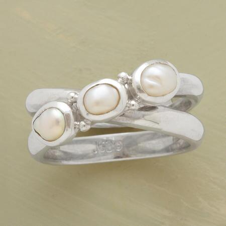This crisscross pearl ring possesses an understated loveliness compatible with your entire wardrobe.