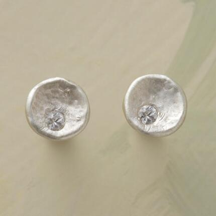These white sapphire and silver stud earrings surprise with their embedded bit of glitter.