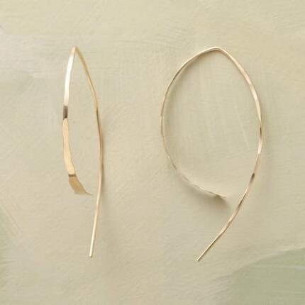 This pair of Melissa Joy Manning gold Wishbone Earrings is a uniquely chic piece.