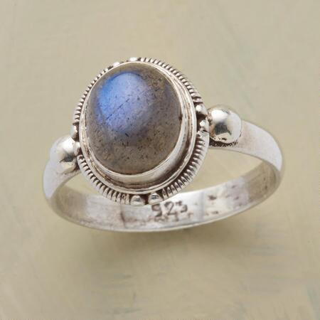 This labradorite gallery ring's stone seems to be lit from within by a flickering blue flame.