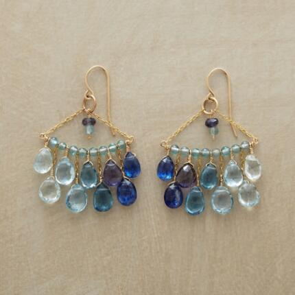 A pair of blue cascade chandelier earrings, rippling from light to dark hues.