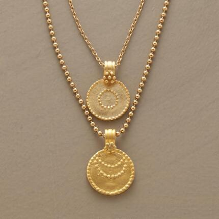 Brightly beautiful, this golden sun and moon necklace will shine a light on your look.