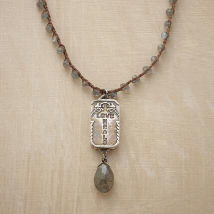 This labradorite locket necklace offers cool elegance and deep meaning.