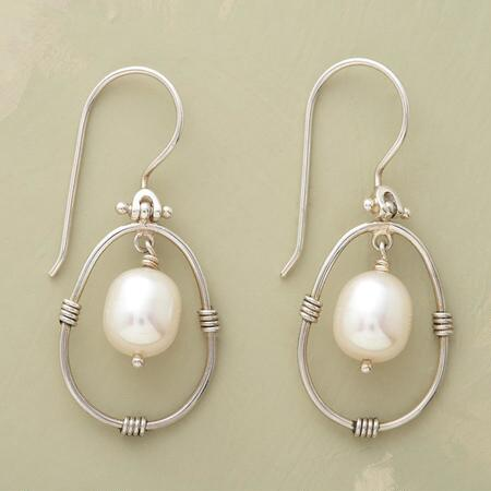 Swinging gracefully, these pendulum white pearl earrings have a hypnotic design.
