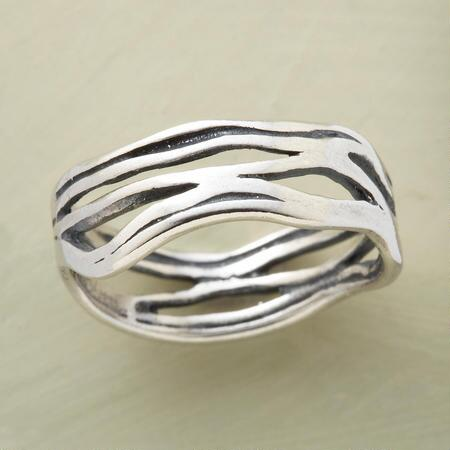 Let the elegance of this handmade sterling silver wave ring wash over you.